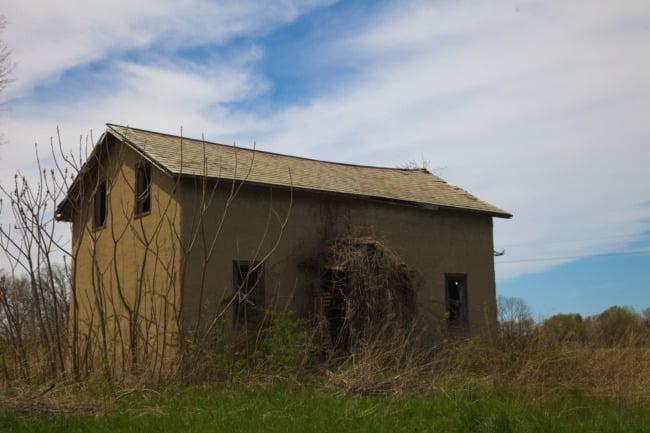 Abandoned Stucco House