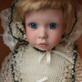 creepy-doll-with-big-blue-eyes