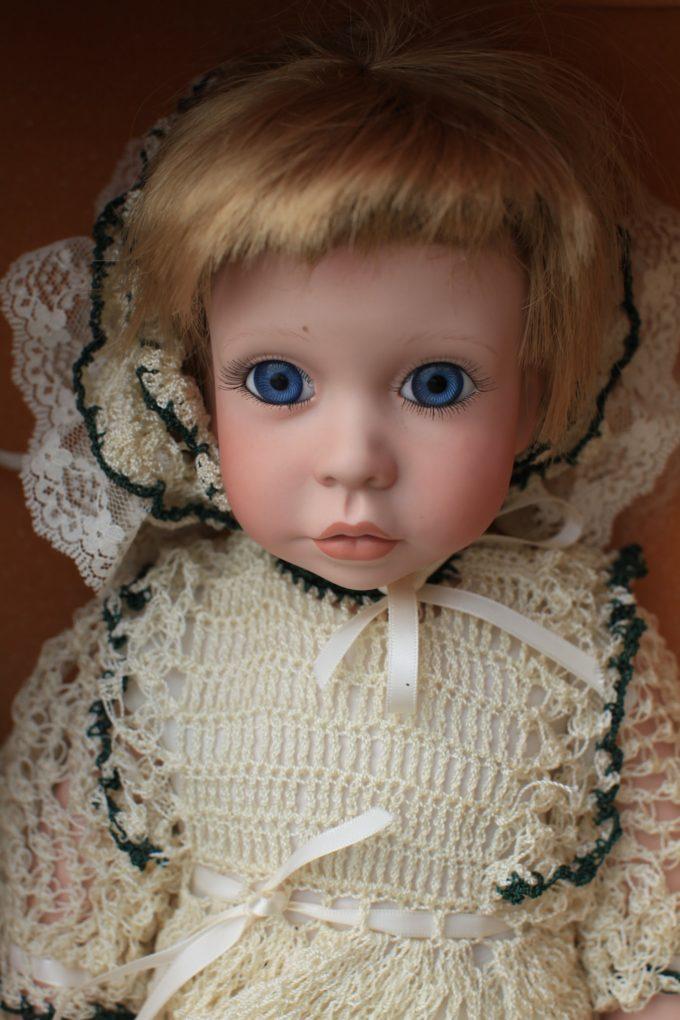 Creepy Doll With Big Blue Eyes