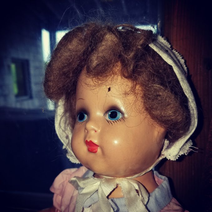 Creepy Doll By The Window